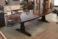 braced arch dining table in walnut
